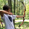 teen boy shooting bow and arrow, archery
