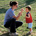 mom feeding toddler son Kona Ice at Family Recess