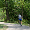 man on bicycle on Holes Creek Trail