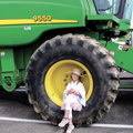 young girl sitting in wheel well at Big Rig Gig