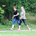 women walking with Nordic Poles