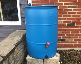 55-gallon blue rain barrel