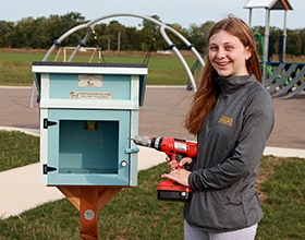 Lauren Shenk installs Little Free Library at Robert F. Mays Park