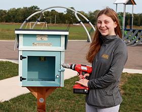 Lauren Shenk installs Little Free Library at Robert F. Mays Park