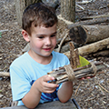 child building a boat at the Nature Playce