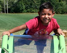 Boy playing on Robert F. Mays Park playground