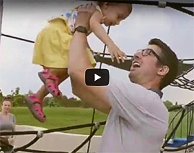 Video cover image of father and daughter on playground