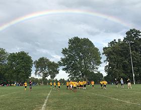 rainbow over football practice at Schoolhouse Park
