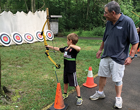 CWPD Volunteer Harry Barnes instructing archery