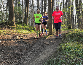 three trail runners at Bill Yeck Park