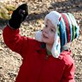 preschool boy looking at acorn