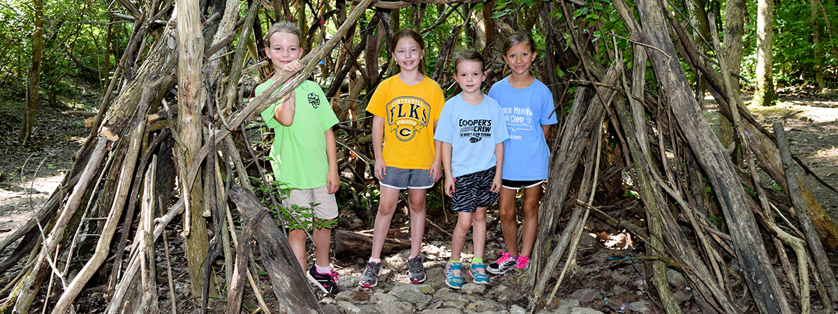 Children in a fort at summer camp