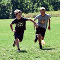 two boys running at Summer Recreation Program