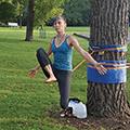 woman balancing on slackline