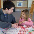 CWPD employee crafting with preschool aged girl