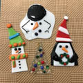 four glass fused ornaments