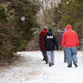 four adults walking in snow at Grant Park