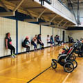 women exercising in gym with strollers