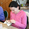woman working on embroidery project