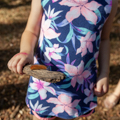 child holding stick with a caterpillar on it