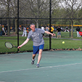 man playing tennis at Schoolhouse Park