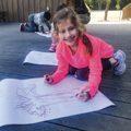 girl working on art
