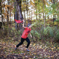 teenage boy running with flag