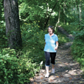 woman walking on wooded trail