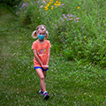 young girl in a mask walking