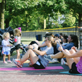 women on exercise mats outdoors