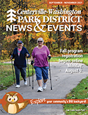 cover of fall 2021 issue of News & Events, adults trail trekking on paved path